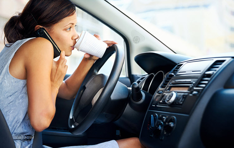 f-Woman-Multitasking-in-Car_Talking_Drinking_Driving